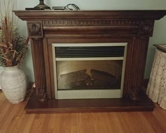 Dimiator electric fire place mantle   $350