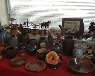 Pottery pieces, folky man and horses plowing, more