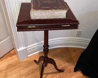Bombay Company book stand and Webster's New international dictionary