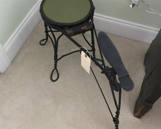 Vintage wrought iron shoe shine bench