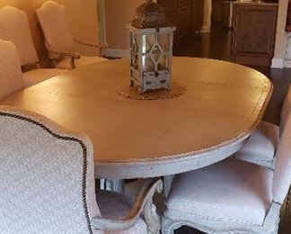 Dining room oval table with 6 chairs.  Distressed, upholstered beautiful fabric chairs