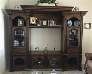 """Solid wood 3 piece lighted TV center/display case.  Measures 100"""" x 20"""" x 91"""". TV opening is 48"""" x 36"""". $599"""