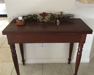 The top of this beautiful solid wood table opens to double in size. $125