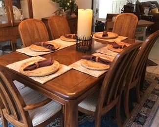 """Looks Brand New!!                                                                 Drexel Heritage solid wood, pecan finish dining set.                                              Table measures 63"""" x 40"""" x 29"""" and comes with (2) 18"""" leaves for a total expansion of 8.25'.   The set includes the table, 6 chairs, china cabinet and buffet/server. $899"""