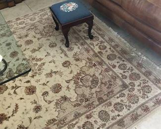 The beautiful rug in beige, cream & maroon measures 8.5' x 5.5' .
