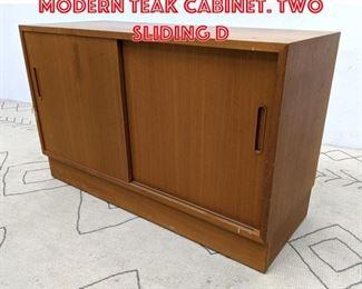 Lot 2176 POUL HUNDEVAD Danish Modern Teak Cabinet. Two Sliding D