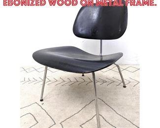 Lot 2319 Eames DCM Chair. Ebonized wood on metal frame.