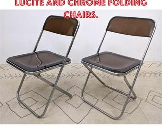 Lot 2354 Pair Italian Smoked Lucite and Chrome Folding Chairs.
