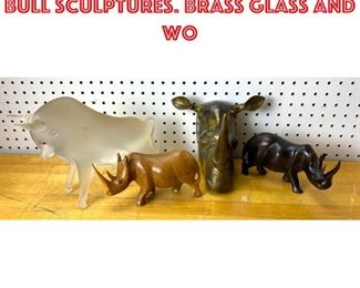 Lot 2556 4pcs Rhinoceros and Bull Sculptures. Brass glass and wo