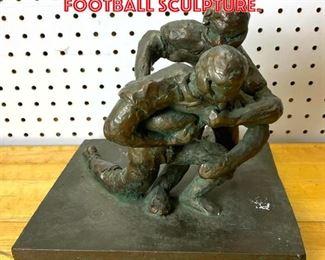 Lot 2563 Bronze finish Modernist Football Sculpture.