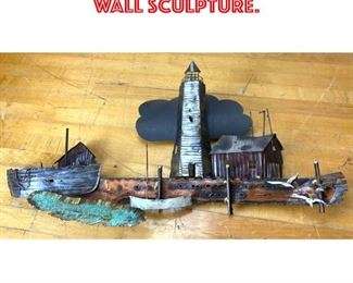 Lot 2583 C JERE style lighthouse wall sculpture.