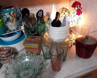 Kitchen dishware and lighted rooster lamp.