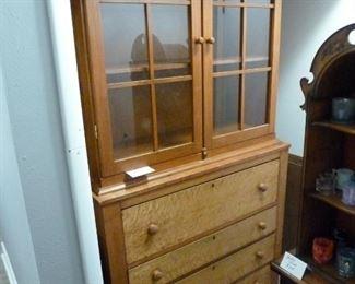 200 y/o maple cabinet