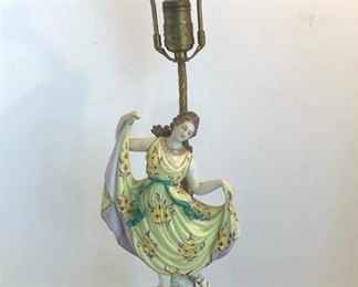 ANTIQUE PORCELAIN FIGURAL LAMP IN THE STYLE OF ROYAL DUX ON DOLPHIN FOOTED METAL BASE