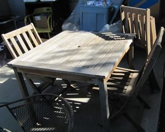 Teak table and four folding chairs