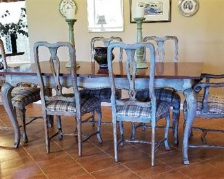 Gorgeous dining table with 6 chairs. The chairs are beautifully painted and great fabric on the seats.