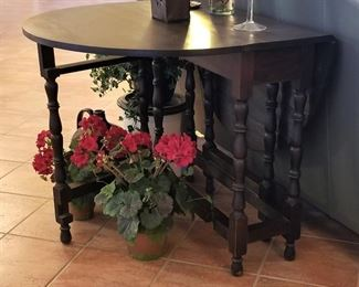 Antique 8 legged gate-leg table. Sides drop down and then it opens to a large table.