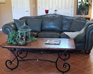 Sage leather sofa and coffee table. There are two sofas.