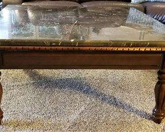 Black and white veined marble topped square coffee table.