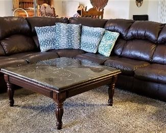 Dark brown Ashley sectional leather sofa. It's a sleeper and has 2 recliners. Comes apart in 3 sections very easily.