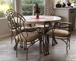 Round metal and white marbled top kitchen/dining table and 4 chairs.