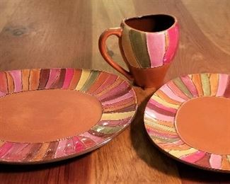 There is a lovely set of these colorful dishes. We have matching linens too.