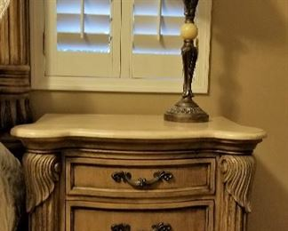 Matching marble top bedside tables.