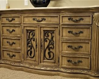 9 outside drawers plus extra inside drawers behind the doors on this matching marble top dresser.