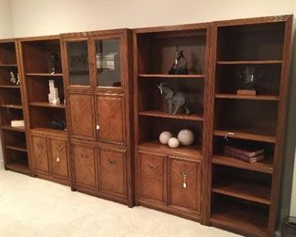 "5 shelving units - each sold separately!  2 smaller units 78"" x 24"", 3 larger units 78"" x 32""   Elephant not for sale!"