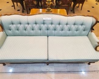 I SO LOVE this vintage couch.  Originally bought it to keep in our jewelry center, but we never have the extra space in any sale.  The couch has been re-upholstered, and is in perfect condition.  Would make a beautiful photography backdrop!