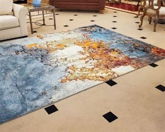 This beautiful large area rug has never been used.  We literally opened the sealed package it came in.  BRAND NEW.
