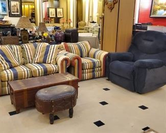 Over-sized recliner!  Notice the vintage ottoman - love it.  The cedar chest is also vintage.