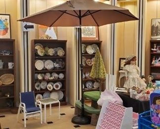 This patio umbrella and stand is in excellent condition.  You need this for your deck!