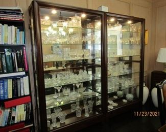 THESE ARE  SEPARATE DISPLAY CABINETS.. ADJUSTABLE GLASS SHELVES AND THEY ARE LIGHTED OF COURSE... JUST INCREDIBLY GORGEOUS