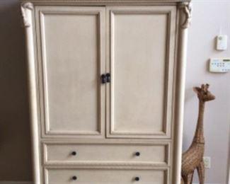 The Cordonet Collection pocket door armoire