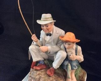 Norman Rockwell Porcelain Figurine Catching the Big One.