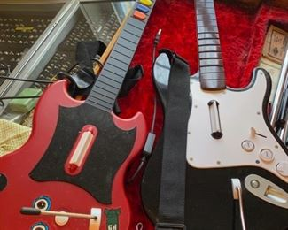 another fender guitar and a toy guitar