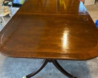 duncan  dining table with two leafs and pads