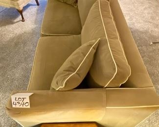 """Lot 4340. $795.00. Ethan Allen contemporary sofa in medium tan w/ cream color piping, 2 cushions on seat and back. Excellent Condition in a great neutral color that will go with anything (the lighting in this home makes photographing difficult, but it's really nice!) Measurements: 76""""L x 36"""" D x 36"""" to top of the cushion, seat height is 19""""."""