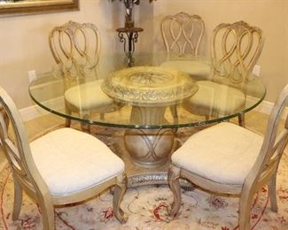 Glass dining table set with 6 chairs.