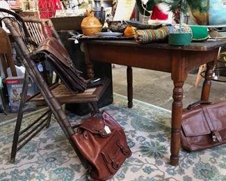 Rustic table. $59. Vintage bamboo chair. $ 29. Vintage leather satchels and new Coach briefcase/satchel.