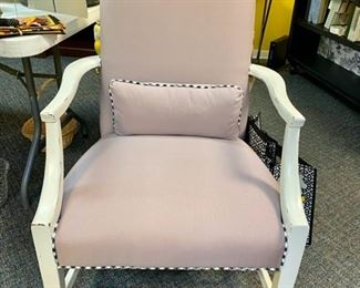 Newly upholstered lavender chair with black and white trim