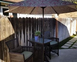 Outdoors Bistro Set with 2 Chairs $300.00 Outdoors Umbrella with Stand  $55.00