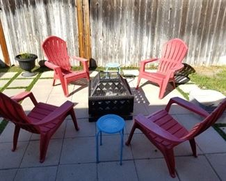 4 Red Hard Plastic Chairs $60.00 Firepit $75.00