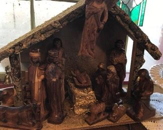 Beautifully carved Nativity Set.  See the lovely stained glass panel peeking in the back and old window.