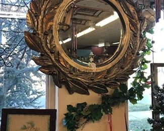 Look at this beautiful laurel leaf mirror