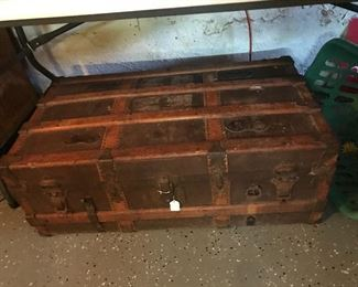 Love this old trunk with wood slats.
