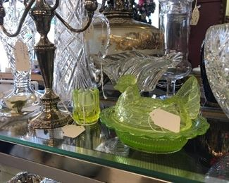 We have beautiful green Vaseline glass and sterling silver candelabras.