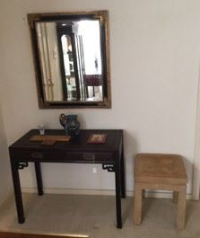 The footstool is sold, but the mirror and side table are still available.