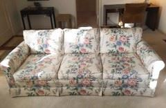 This comfortable sofa is waiting for a good home.